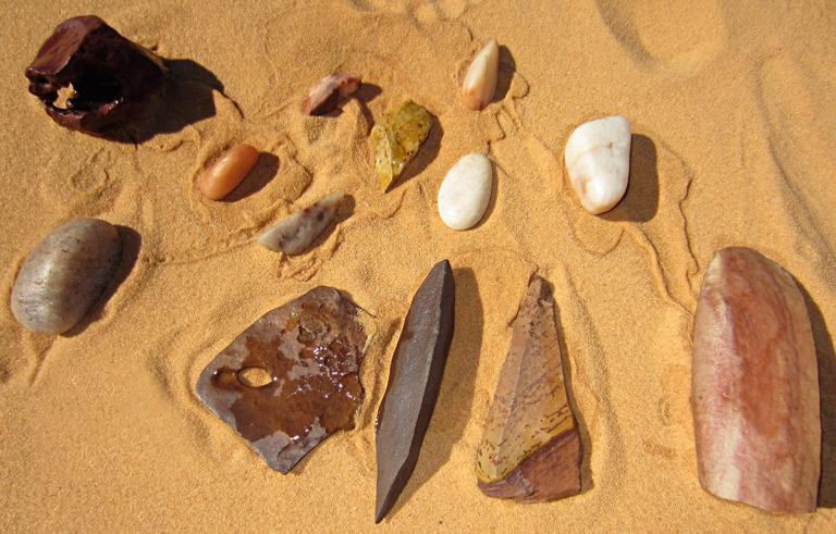 a random assortment of stones and tools from the location exemplify the typical wind-blown sand polish effect, 2012